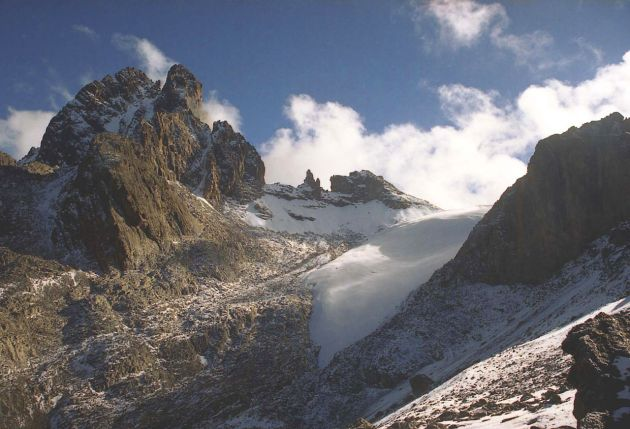 The Lewis glacier is the largest on Mount Kenya The summit of Mt Kenya. Along the skyline: Batian (5,199m), the Gates of Mist, Nelion (5,188m), Thompson's Flake, Pt Thompson (4,955m) and the Lewis Glacier. Pt Melhuish (4,880m) is the peak in front of Batian. The photo is taken on the Naro Moru route en route to the Austrian Hut