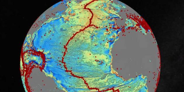 AFBEELDING //Op de afbeelding bovenaan zie je het zwaartekrachtsmodel van de Noord-Atlantische Oceaan. De rode stipjes die je ziet, zijn aardbevingen.